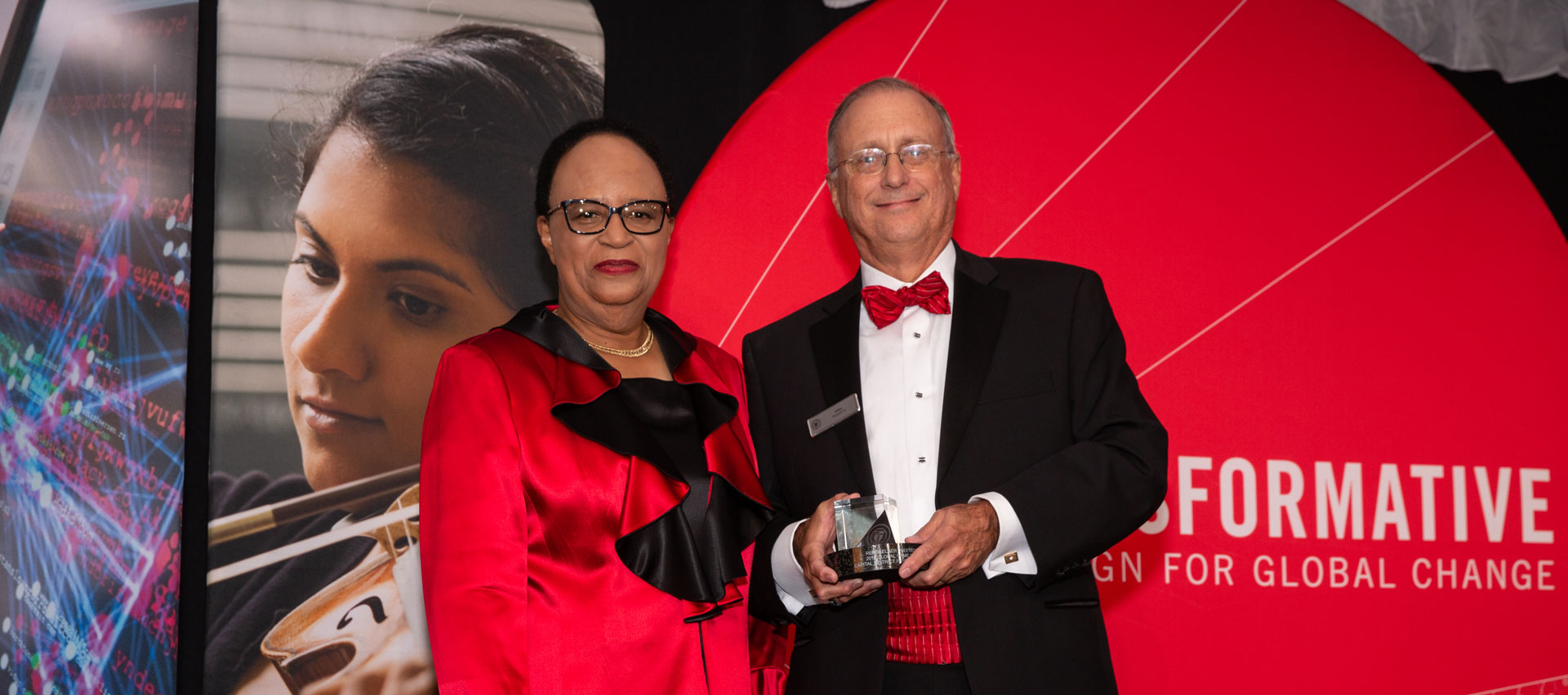 Dr. John D. Bennett '74, CDPHP president, and CEO, receives the Global Game Changers award from Dr. Shirley Ann Jackson at 2019 Scholarship Gala.